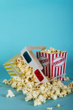 Popcorn bucket against a blue background Royalty Free Stock Images