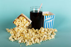 Popcorn bucket against a blue background Royalty Free Stock Photography