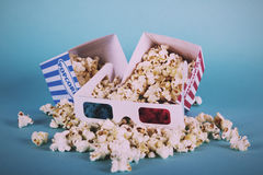 Popcorn bucket against a blue background Vintage Retro Filter. Royalty Free Stock Photos