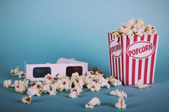 Popcorn bucket against a blue background Vintage Retro Filter. Royalty Free Stock Photography