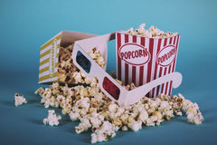 Popcorn bucket against a blue background Vintage Retro Filter. Stock Image