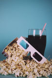 Popcorn bucket against a blue background Vintage Retro Filter. Royalty Free Stock Photo