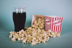 Popcorn bucket against a blue background Vintage Retro Filter. Royalty Free Stock Images