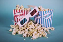 Popcorn bucket against a blue background Vintage Retro Filter. Stock Photography