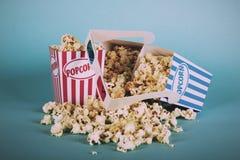 Popcorn bucket against a blue background Vintage Retro Filter. Stock Photos