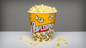 Popcorn bucket with kernels Stock Photo