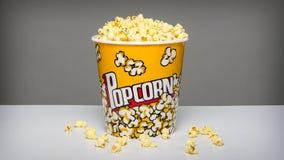 Popcorn bucket with kernels. Image of a bucket of popcorn Stock Photo