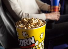 Popcorn Bucket With Man Sitting In Theater Royalty Free Stock Photo