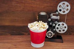 Popcorn bucket and music box in the form of an old movie camera Royalty Free Stock Photos