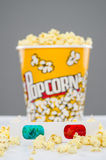 Popcorn bucket overflowing and 3d glasses Royalty Free Stock Photography