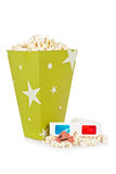 Popcorn bucket, two tickets and 3D glasses. Popcorn bucket with two tickets and 3D anaglyph glasses isolated on a white background Royalty Free Stock Photo
