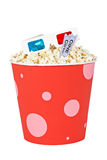 Popcorn bucket, two tickets and 3D glasses. Popcorn bucket with two tickets and 3D anaglyph glasses isolated on a white background Royalty Free Stock Images
