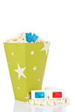Popcorn bucket, two tickets and 3D glasses Royalty Free Stock Image