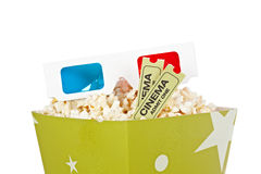 Popcorn bucket, two tickets and 3D glasses. Popcorn bucket with two tickets and 3D anaglyph glasses isolated on a white background Royalty Free Stock Image