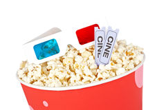 Popcorn bucket, two tickets and 3D glasses. Popcorn bucket with two tickets and 3D anaglyph glasses isolated on a white background stock photography
