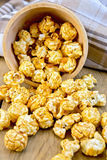 Popcorn caramel on board in bowl with napkin Royalty Free Stock Image