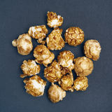 Popcorn in caramel  on gray background Stock Photography