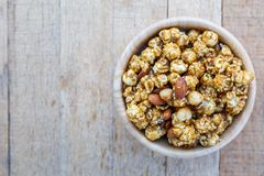Popcorn caramel mix macadamia and almond taste. On wood table with copy space. top view Stock Photography