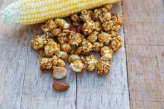 Popcorn caramel mix macadamia and almond taste. On wood table with copy space Stock Photography