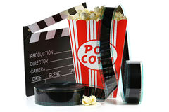 Popcorn. In a cardboard container with clapperboard and filmstrip isolated on white background Stock Photos