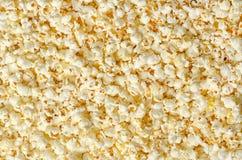 Popcorn, cereale schioccato, superficie e fondo immagini stock libere da diritti