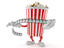 Popcorn character holding film strip. On white background Stock Image