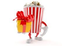 Popcorn character holding gift. Isolated on white background Stock Photo