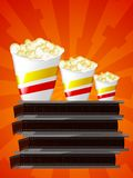 Popcorn and cinema. Illustration of cups of popcorn with cinema's bobines Stock Photos