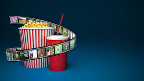 Popcorn for cinema and movie film tape on blue background.  Stock Images