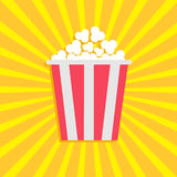 Popcorn. Cinema movie icon in flat design style. Starburst background Stock Photo