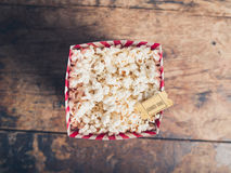 Popcorn and cinema ticket Stock Photos