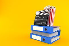 Popcorn and clapboard with ring binders. Isolated on orange background. 3d illustration Royalty Free Stock Photo