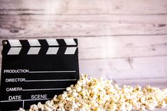 Popcorn and clapperboard stock photos