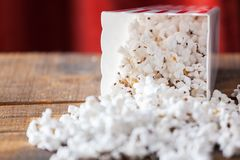 Popcorn In Classic Cinema Serving Box On Wood Background With Re Stock Photo
