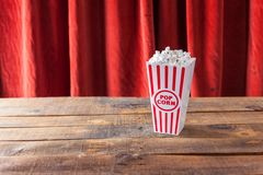 Popcorn In Classic Cinema Serving Box On Wood Background With Re Stock Image