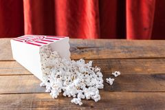 Popcorn In Classic Cinema Serving Box On Wood Background With Re Royalty Free Stock Photo