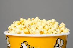 Popcorn. Closeup of popcorn bucket overflowing Royalty Free Stock Photography