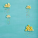 Popcorn Clouds With Colorful Rain Royalty Free Stock Image