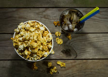 Popcorn and cola with ice. Popcorn and cola on the black background stock photos
