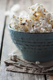 Popcorn and cola on the wooden table. Selective focus Royalty Free Stock Photography