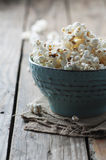 Popcorn and cola on the wooden table Stock Photography