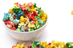 Popcorn. Colored popcorn on the white background Stock Images