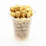 Popcorn combined with caramel syrup in a plastic cup Royalty Free Stock Photography