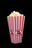 Popcorn container on a black background Stock Photo