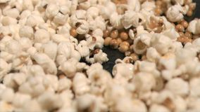 Popcorn cooking in super slow motion on a pan Royalty Free Stock Images
