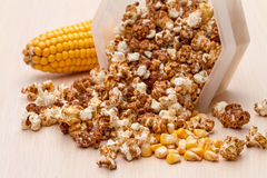 Popcorn and corn on the cob Stock Images
