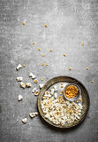 The popcorn with corn in a old pan. Royalty Free Stock Image