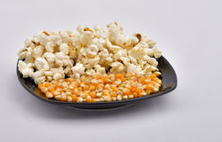 Popcorn. And corn on a plate Stock Photo
