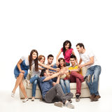 Popcorn couch fight. Friends fighting over popcorn while watching movie Royalty Free Stock Images