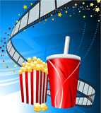 Popcorn and cup of soda on film background Stock Image